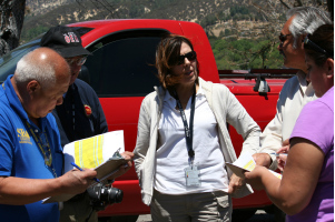 """Photo courtesy Cal EMA:  Virgilio """"Gil"""" Macion of the U.S. Small Business Administration (far left) , Michael Hooper of the Los Angeles County Office of Emergency Management, CSLEA member Sonia Brown of the Cal EMA Southern Region, Francis Dominguez of the Los Angeles County Department of Public Works and CSLEA member Theresa Gonzales of Cal EMA discuss property impacted by the Powerhouse Fire during a joint Preliminary Damage Assessment conducted by Cal EMA and the SBA on June 17 to verify fire-related damages."""