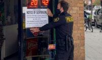 ABC Agents Post Notice of Suspension at Long Beach Liquor Store